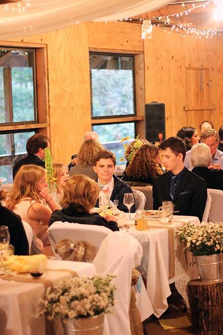 Dining in activity barn, wedding reception