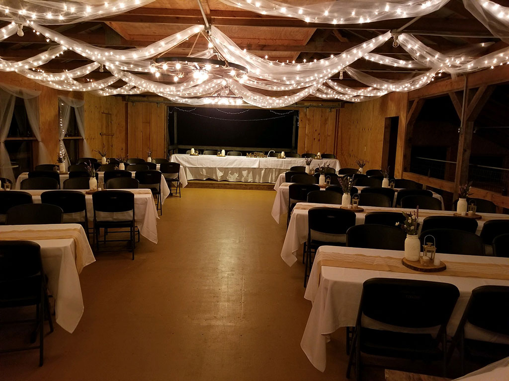 activity barn decorated for nighttime wedding